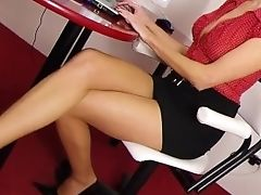 Sexy Assistant In Mini Micro-skirt And Skin Colored Stocking And Black High Stilettos Makes Fantastic Footjob